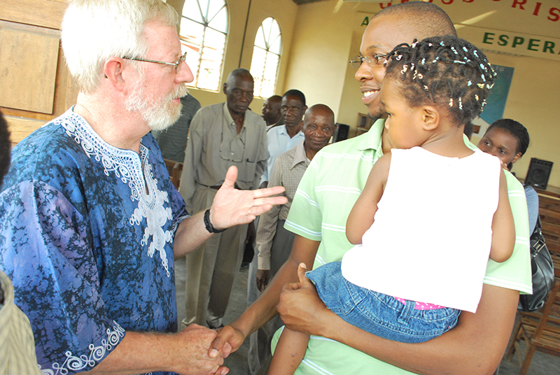 Tim Cearley greets worshippers as they leave First Baptist Church of Chimoio, Mozambique on Sunday morning in Dec 2012. Photo courtesy of Matt Cearley