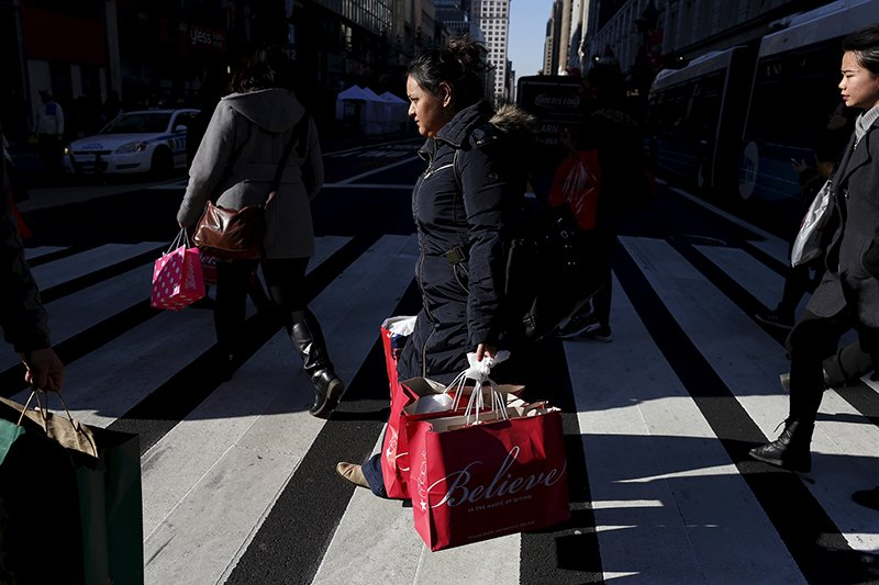 Shoppers cross 34th St. in Herald Square in the Manhattan borough of New York, on November 24, 2015. Photo courtesy of REUTERS/Brendan McDermid *Editors: This photo may only be republished with RNS-CHRISTMAS-BOYCOTTS, originally transmitted on Nov. 25, 2015.
