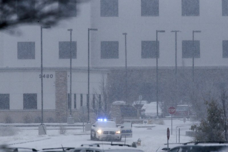 A police vehicle is seen left with the doors open at a Planned Parenthood clinic in Colorado Springs where a gunman killed three in an attack Nov. 27. Photo by Isaiah J. Downing courtesy of Reuters