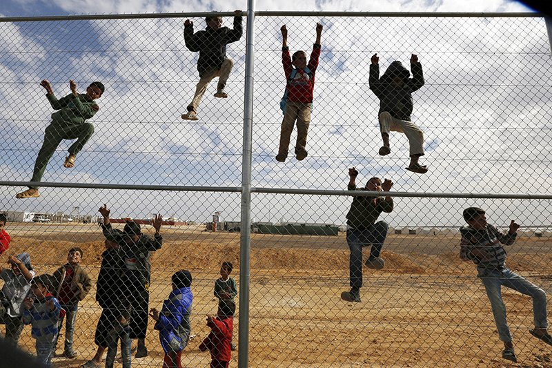 Syrian refugee children climb on a fence to watch a football training workshop in a refugee camp to provide Syrian and Jordanian trainers with football training skills, at Azraq refugee camp near Al Azraq city, Jordan, on November 16, 2015. Photo courtesy of REUTERS/Muhammad Hamed *Editors: This photo may only be republished with RNS-EVANGELICALS-REFUGEES, originally transmitted on Nov. 18, 2015.
