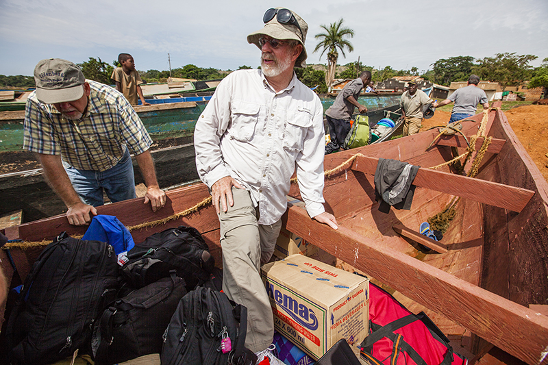 Christian worker Tim Cearley, center, helps unload a boat after arrival to a village on Lake Victoria in Uganda. Photo courtesy of IMB