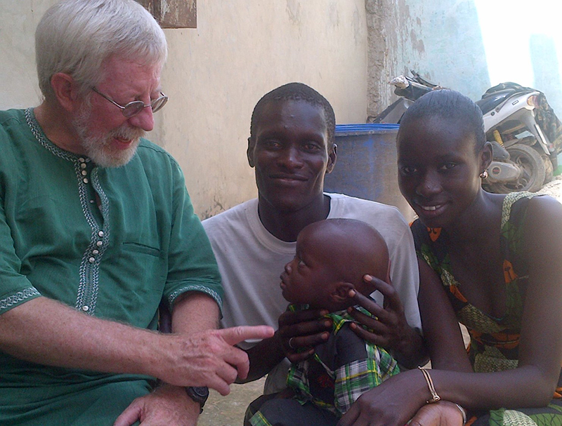 Christian worker Tim Cearley, interacts with a child during a mission in Africa. Photo courtesy of Tim Cearley