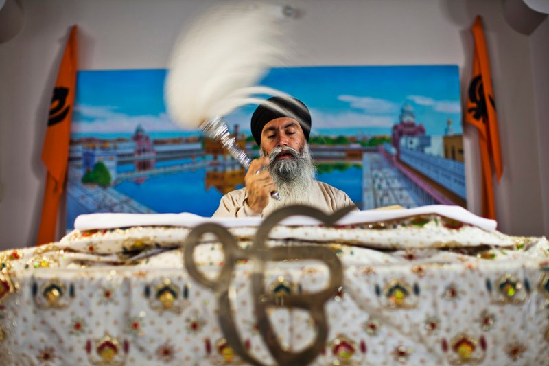 Parvinder Singh reads from the Guru Granth Sahib, the holy book of Sikhs, at the Gurdwara Sahib Sikh Temple in West Sacramento, California on August 6, 2012. Photo courtesy of REUTERS/Max Whittaker *Editors: This photo may only be republished with RNS-MENON-COLUMN, originally transmitted on Nov. 9, 2015.