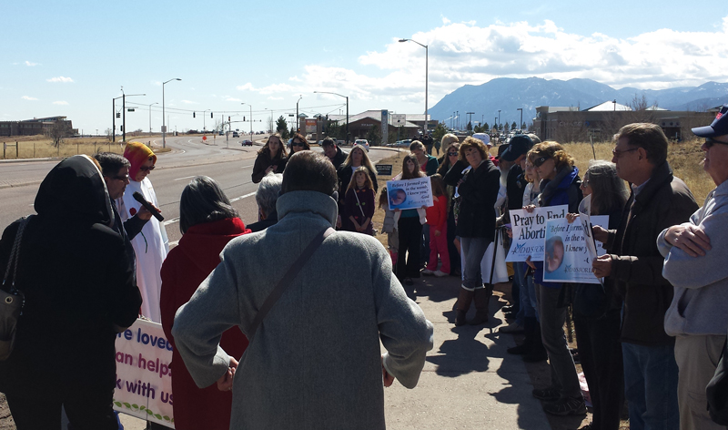 Father Bill Carmody and others gather for a Mass near Planned Parenthood in Colorado Springs in 2014. Photo courtesy of Michele Mason