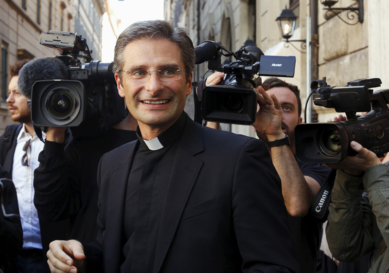 Monsignor Krzystof Charamsa smiles as he leaves at the end of his news conference in downtown Rome on October 3, 2015. Photo courtesy of REUTERS/Alessandro Bianchi *Editors: This photo may only be republished with RNS-POLISH-PRIEST, originally transmitted on Nov. 9, 2015.