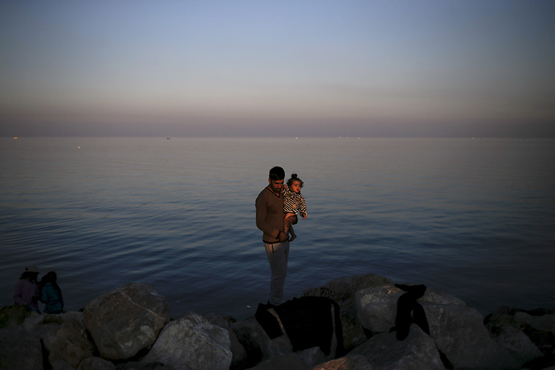 A Syrian refugee holds a baby at the port of Mytilene on the Greek island of Lesbos, on November 5, 2015. Photo courtesy of REUTERS/Alkis Konstantinidis *Editors: This photo may only be republished with RNS-RUDIN-COLUMN, originally transmitted on Nov. 18, 2015.
