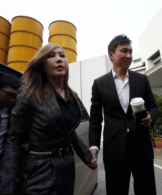City Harvest Church founder Kong Hee (R) and his wife Sun Ho, also known as Ho Yeow Sun, drew jail terms for stealing millions from his Singapore megachurch. REUTERS/Edgar Su