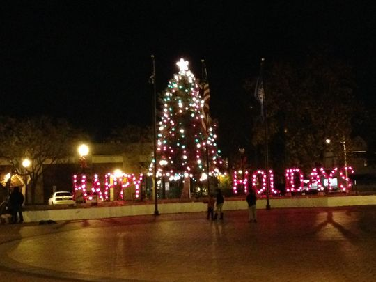 A complaint over a menorah set up beside a decorated Christmas tree in Lakewood, N.J.'s town square has triggered the menorah's removal and upset numerous residents and at least one downtown merchant, who says township officials acted rashly. (Photo by Shannon Mullen, Asbury Park Press.)