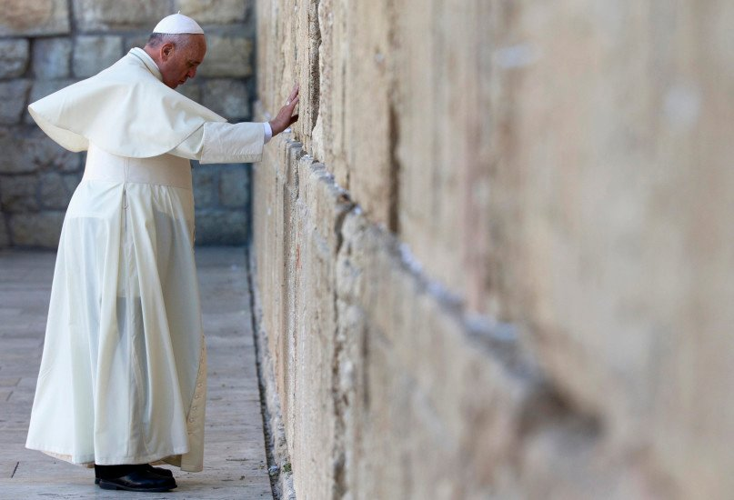 Pope Francis prays at the Western Wall, the holiest place where Jews can pray, in the old city of Jerusalem, Israel, Monday, May 26, 2014. (AP Photo/Andrew Medichini, Pool)