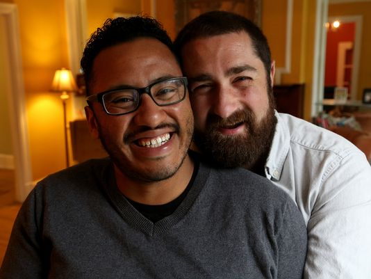 Tom Molina-Duarte and husband Bryan Victor in their home. (Photo: Eric Seals, Detroit Free Press)