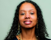 Wheaton College history professor Larycia Hakwins has been told she faces a termination-for-cause proceeding for her view that Christians and Muslims worship the same God.