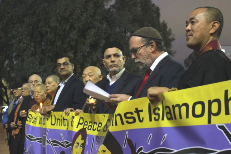 Rabbi Aryeh Cohen (second from right) reads a message of solidarity against Islamophobia, surrounded by Muslim, Buddhist and other religious leaders at a candlelight vigil in Los Angeles' Little Tokyo neighborhood. Photo by Megan Sweas, RNS.