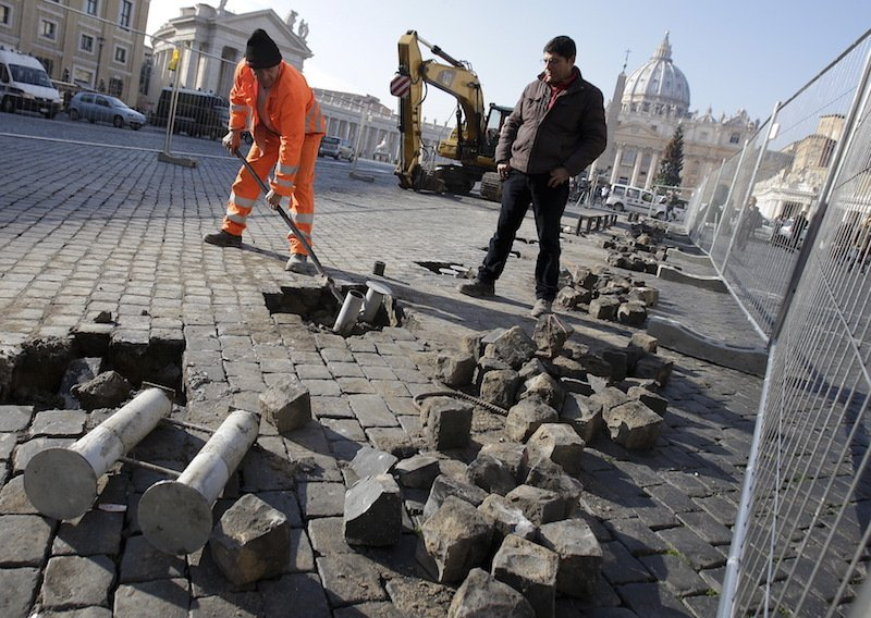 Laborers work in front of the Vatican in Rome, Italy, December 4, 2015. Rome is bracing for the arrival of millions of pilgrims for the 12-month Jubilee Year of Mercy. Photo courtesy REUTERS/Max Rossi