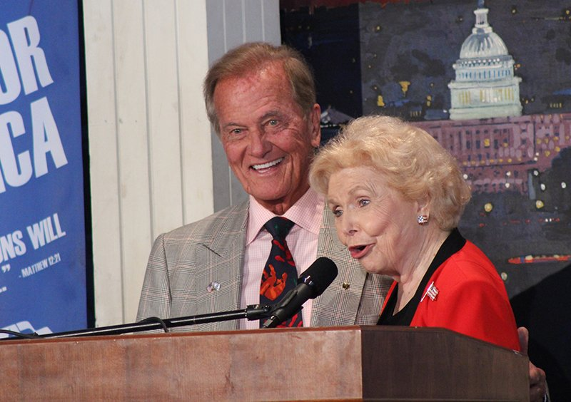 (RNS15-may2) Vonette Bright, the co-chairman of the National Day of Prayer Task Force introduces singer Pat Boone at the National Day of Prayer observance on Capitol Hill on Thursday (May 2) in Washington. RNS photo by Adelle M. Banks.