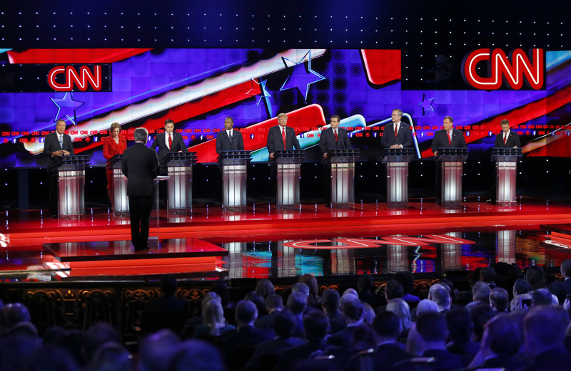 Republican U.S. presidential candidates (L-R) Governor John Kasich, former HP CEO Carly Fiorina, Senator Marco Rubio, Dr. Ben Carson, businessman Donald Trump, Senator Ted Cruz, former Governor Jeb Bush, Governor Chris Christie and Senator Rand Paul participate in the Republican presidential debate in Las Vegas, Nevada on December 15, 2015. Photo courtesy of REUTERS/Mike Blake