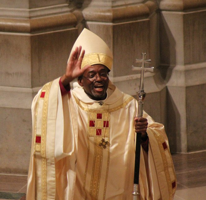 Episcopal Church Presiding Bishop Michael Curry waves at the conclusion of his installation service on Nov. 1, 2015 at Washington National Cathedral. Religion News Service photo by Adelle M. Banks