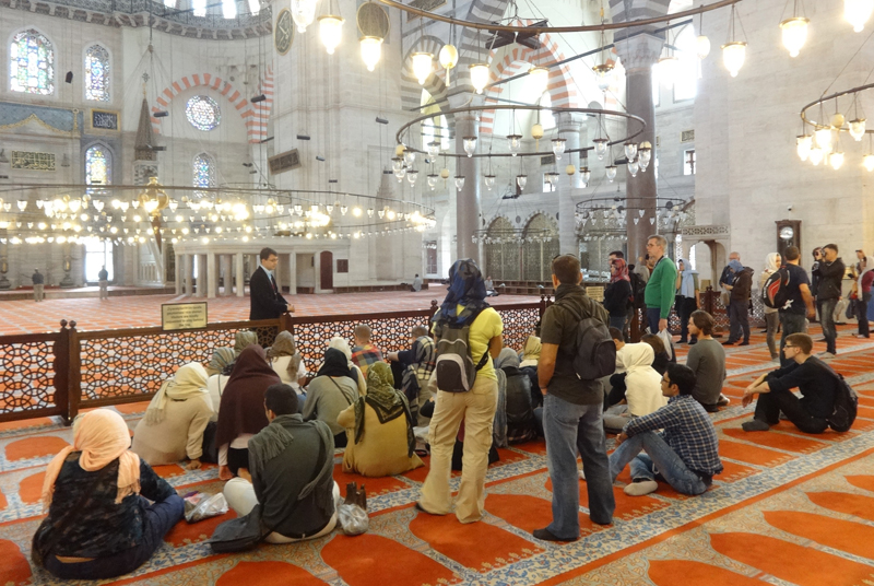 Volunteers with the Center for Cross-Cultural Communication answer questions about Islam from tourists visiting Istanbul's medieval Süleymaniye Mosque. Photo courtesy of Center for Cross-Cultural Communication