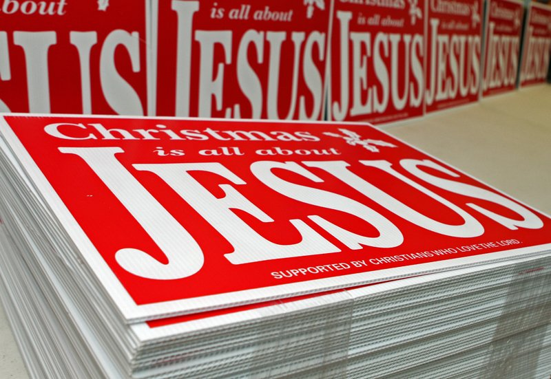 """The Rev. Jimmy Terry has printed thousands more yard signs that read """"Christmas is all about Jesus,"""" and he plans to distribute them across all of Tennessee's 95 counties. Photo by Tony Centonze, for the Leaf-Chronicle, courtesy of USA Today"""