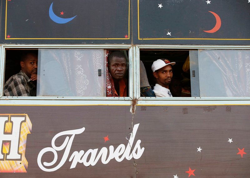 Men look out of bus windows, as it travels to Nairobi, in Mandera town at the Kenya-Somalia border, on December 6, 2014. Somali al Shabaab Islamist militants killed 36 non-Muslim workers at a quarry in Mandera, northeast Kenya on Tuesday, prompting the president to sweep out his top security officials in order to tackle a relentless wave of violence. Photo courtesy of REUTERS/Goran Tomasevic *Editors: This photo may only be republished with RNS-KENYA-MUSLIMS, originally transmitted on Dec. 22, 2015.