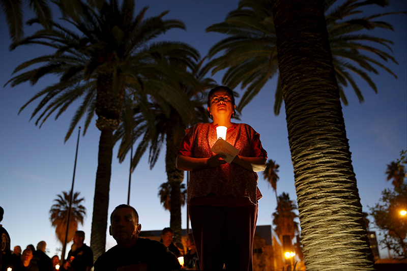 Elvina Guerrero, 57, holds a candle during a vigil for San Bernardino County employees after a shooting in San Bernardino, California on December 7, 2015. Photo courtesy of REUTERS/Patrick T. Fallon *Editors: This photo may only be republished with RNS-MARSHALL-COLUMN, originally transmitted on Dec. 9, 2015.