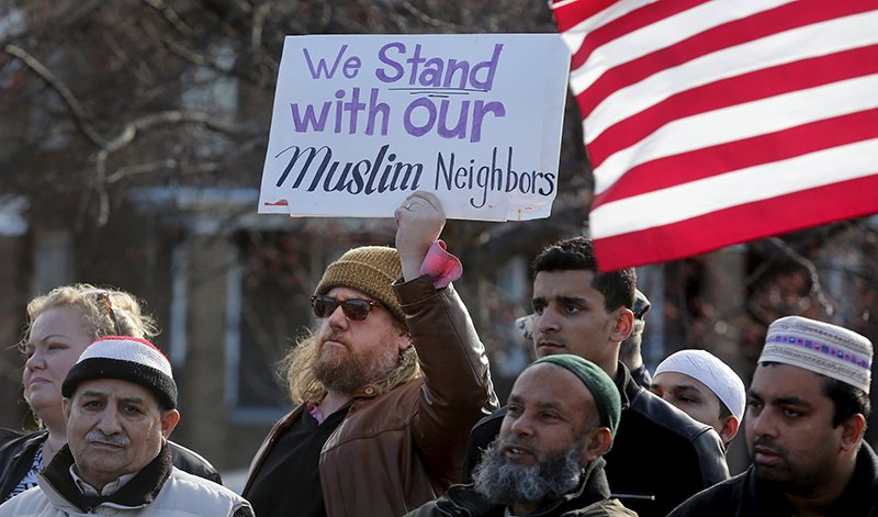 Frank Woodman holds a sign in support of his Muslim neighbors as he joins Bangladeshi and Yemeni Americans to protest against Islamic State and political and religious extremism during a rally in the Detroit suburb of Hamtramck, Michigan on December 11, 2015. Photo courtesy of REUTERS/Rebecca Cook *Editors: This photo may only be republished with RNS-MOSQUE-SECURITY, originally transmitted on Dec. 15, 2015.