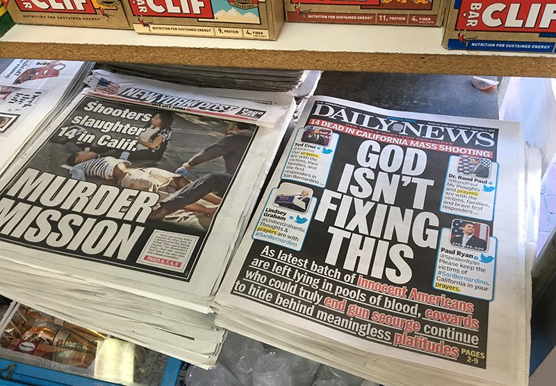 The New York Daily News front cover reads 'God Isn't Fixing This' sits on news stands in Brooklyn, New York on December 3, 2015. Religion News Service photo by David Gibson