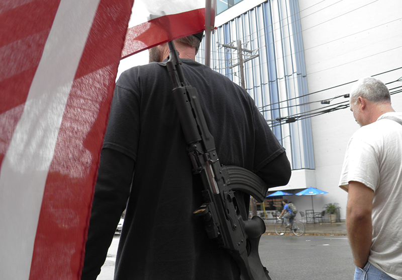 Pro-gun advocates take to the streets outside the University of Texas ahead of a 'mock mass shooting' event where they used cardboard cut-outs rifles, the simulated bangs of bullets on bullhorns and doused fake victims with fake blood, in Austin, Texas, on December 12, 2015. Photo courtesy of REUTERS/Jon Herskovitz *Editors: This photo may only be republished with RNS-PALLY-COLUMN, originally transmitted on Dec. 16, 2015.