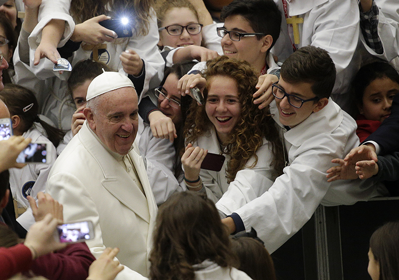 """Pope Francis arrives to lead a special audience for """"Pueri Cantores"""" in Paul VI Hall at the Vatican on December 31, 2015. Photo courtesy of REUTERS/Max Rossi"""