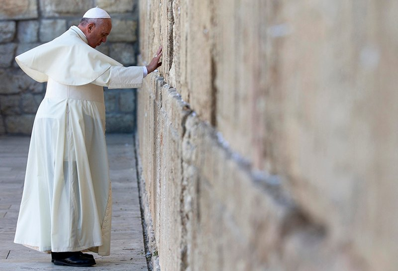 Pope Francis touches the stones of the Western Wall, Judaism's holiest prayer site, in Jerusalem's Old City on May 26, 2014. (AP Photo/Andrew Medichini, Pool)