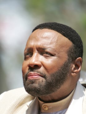 Eight-time Grammy-winning contemporary gospel singer Andrae Crouch listens to speeches before receiving a star on the Hollywood Walk of Fame in Hollywood, on June 4, 2004. Photo courtesy of REUTERS/Lucy Nicholson *Editors: This photo may only be republished with RNS-RELIGION-OBITS, originally transmitted on Dec. 30, 2015.