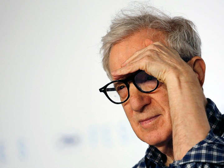 Director Woody Allen gestures as he attends a news conference for the film