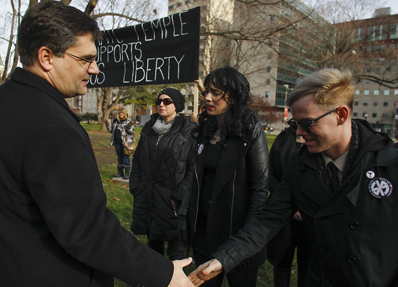 Conservative State Senator Patrick Colbeck of the 7th District thanks members of the Satanic Temple of Detroit for attending the rally for religious liberty at the State Capitol on December 2, 2015. Photo courtesy of USA Today