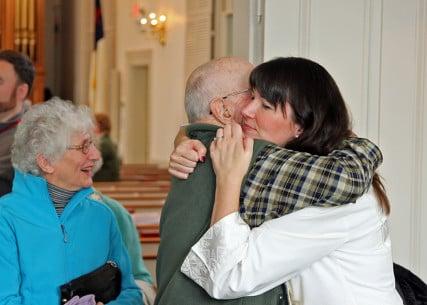 Pastor Robin Bartlett hugs a member of the First Church congregation in Sterling, Mass. Photo by Matt Lucarelli, courtesy of First Church