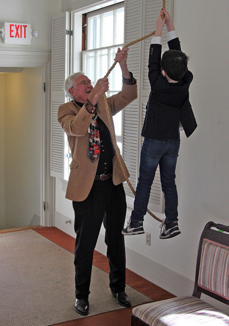 Bob Kneeland, left, and Jackson Crosby ring the church bell at First Church in Sterling, Mass. Photo by Matt Lucarelli, courtesy of First Church