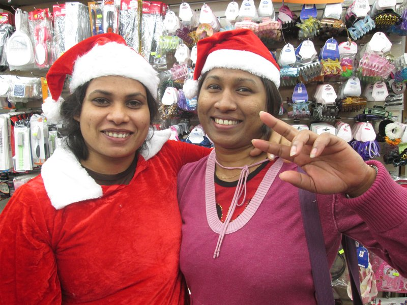 Shama Senanayakgi, left, and her friend Dharshani Dias, foreign caregivers from Sri Lanka, go Christmas shopping in the Tel Aviv bus station, the best place in the city to buy Christmas items. Religion News Service photo by Michele Chabin