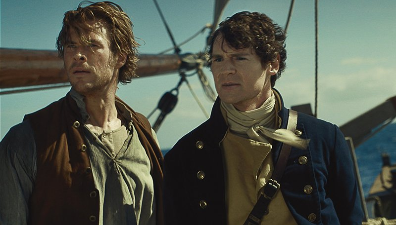 Chris Hemsworth, left, as Owen Chase and Benjamin Walker as George Pollard in Warner Bros. Pictures' and Village Roadshow Pictures' action adventure