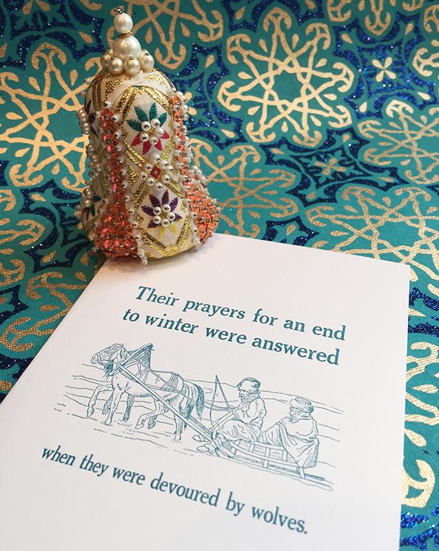 """Wolves"" anti-holiday card. Religion News Service photo by Kimberly Winston."