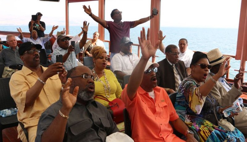 Members of the Church of God in Christ denomination pray during a boat ride on Israel's Sea of Galilee with the International Fellowship of Christians and Jews last summer. Photo courtesy of Phil Lewis/The Fellowship