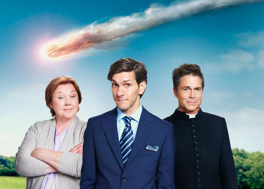 Left to right, Pauline Quirke as Paula Winton, Matthew Baynton as Jamie Winton, and Rob Lowe as Father Jude Sutton in 'You, Me and the Apocalypse.' Photo by Guy Levy/WTTV Productions Limited, courtesy of NBC Universal