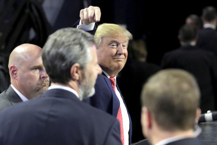 U.S. Republican presidential candidate Donald Trump points to Liberty University President Jerry Falwall, Jr. after speaking in Lynchburg, Virginia, on January 18, 2016. Photo courtesy of REUTERS/Joshua Roberts