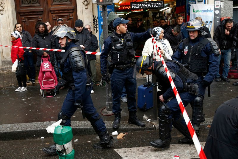 French police secure the area after a man was shot dead at a police station in the 18th district in Paris, France, January 7, 2016. Police in Paris on Thursday shot dead a knife-wielding man who tried to enter a police station, police union sources said. The incident took place on the anniversary of last year's deadly Islamist militant attacks on the Charlie Hebdo satirical magazine in the French capital. REUTERS/Benoit Tessier.
