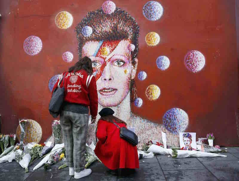 Two women stop at a mural of David Bowie in Brixton, south London, January 11, 2016. By Stefan Wermuth courtesy of Reuters