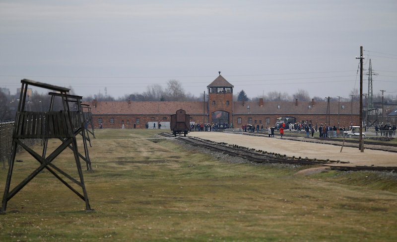 Visitors gather on the grounds of the former Nazi German concentration and extermination camp Auschwitz-Birkenau near Oswiecim, Poland January 27, 2016, to mark the 71st anniversary of the liberation of the camp by Soviet troops and to remember the victims of the Holocaust. Photo courtesy REUTERS/Kacper Pempel -