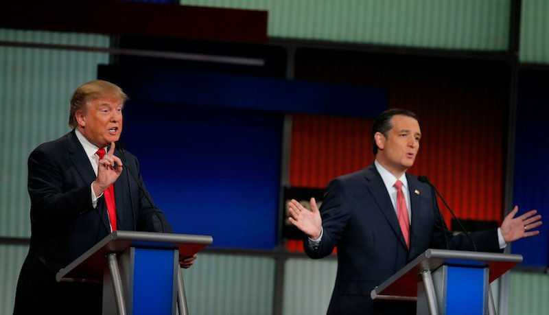 Republican U.S. presidential candidates businessman Donald Trump (L) and Senator Ted Cruz speak simultaneously at the Fox Business Network Republican presidential candidates debate in North Charleston, South Carolina, January 14, 2016. Photo courtesy REUTERS/Chris Keane