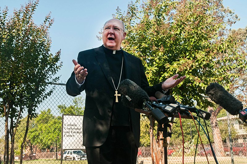 Dallas Bishop Kevin J. Farrell answers questions from media on Oct. 20, 2014, about what will happen to the diocese's building in South Dallas where Ebola victim Thomas Duncan's financee and her family were quarantined. Photo courtesy of The Texas Catholic, via Catholic New Service