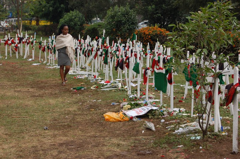 A young woman walks along a line of crosses planted at Uhuru Park to remember the students who died in the Garissa University attack. Religion News photo by Fredrick Nzwili