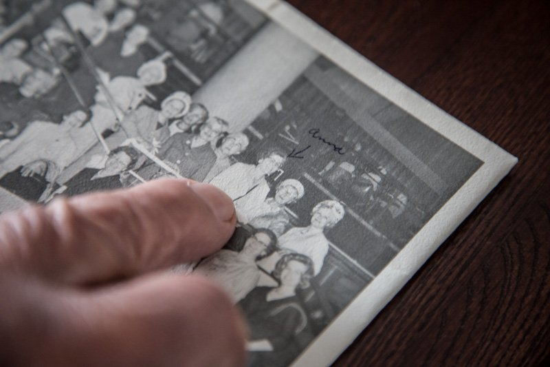A nephew of Anna Kurzweil points out his aunt, in a photograph taken during her 1966 trip to Europe with the Central Missouri State College group, at his Missouri home on January 22, 2016. Religion News Service photo by Sally Morrow