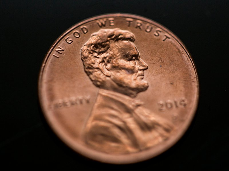 """In God We Trust"" appears on a penny. Religion News Service photo by Sally Morrow"