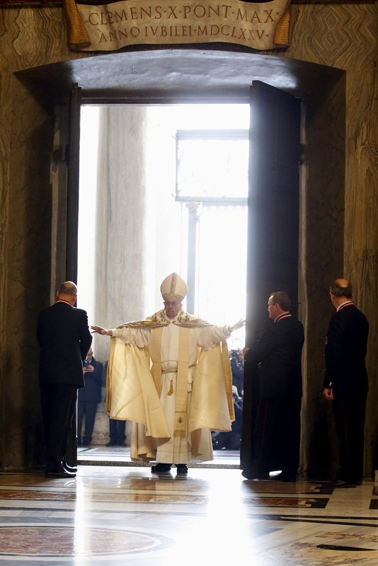 Pope Francis opens the Holy Door to mark opening of the Catholic Holy Year, or Jubilee, in St. Peter's basilica, at the Vatican, on December 8 ,2015. Photo courtesy of REUTERS/Alessandro Bianchi *Editors: This photo may only be republished with RNS-POPE-INDULGENCES, orginally transmitted on Jan. 15, 2016.