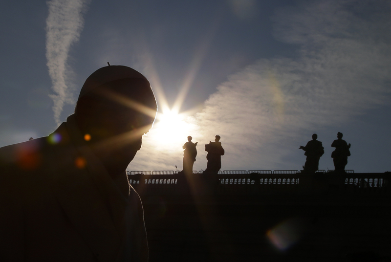 Pope Francis is silhouetted as he arrives to lead the weekly audience in Saint Peter's Square at the Vatican on December 30, 2015. Photo courtesy of REUTERS/Max Rossi *Editors: This photo may only be republished with RNS-POPE-LENT, originally transmitted on Jan. 26, 2016.